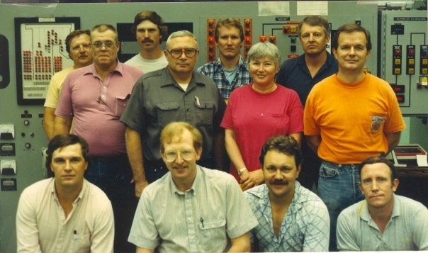 Gene Day is the one standing on the right with the Orange shirt.