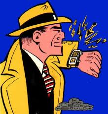 Dick Tracy in a control room of a power plant sending commands to the hopper nozzle booster pumps