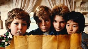 The Goonies looking at the treasure map