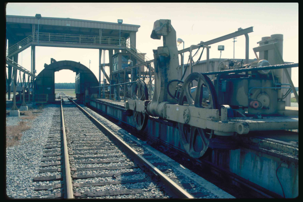 The piece of equipment with the large wheels is the positioner It can pull a coal train full of coal forward to precisely the proper position