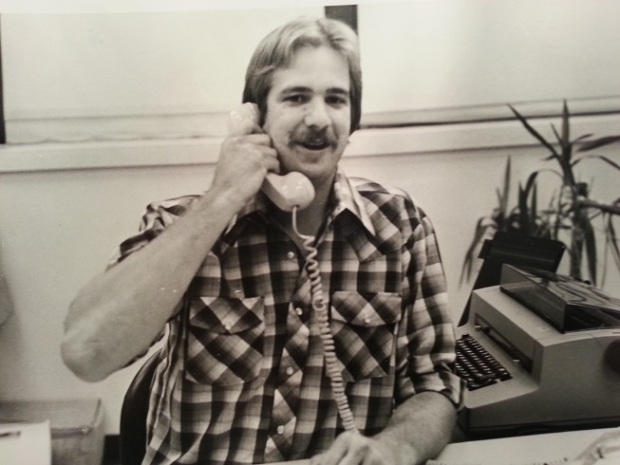 Grant Harned answering the phone at the plant while he worked as the receptionist.